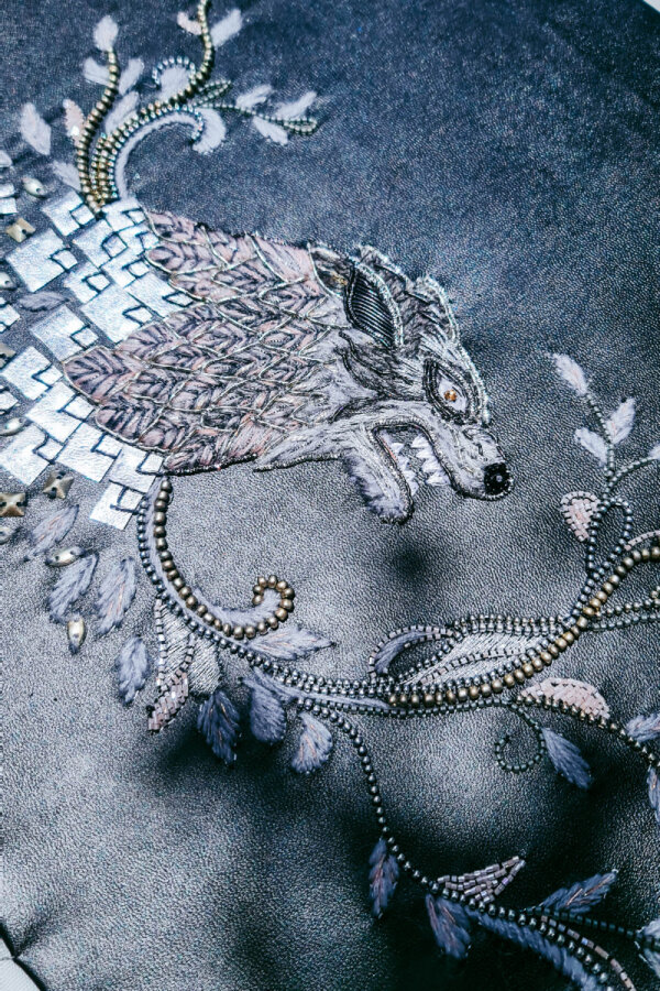 Thread and beads embroidered direwolf head
