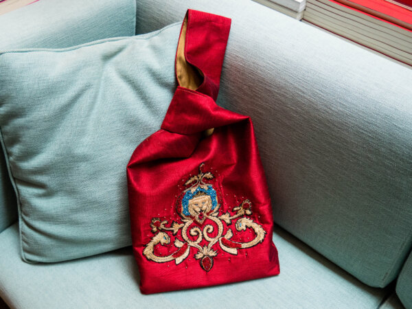 Thread and beads embroidered Lannister sigil